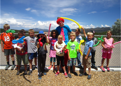 kids smiling with clown