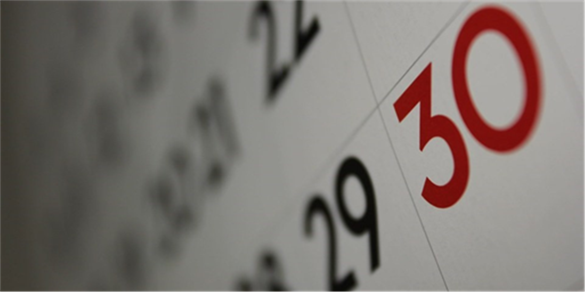 Zoomed in angle of a calendar with the final date, 30, in red