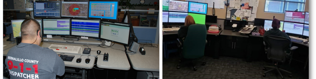 Emergency service technicians sitting in front of multi-monitor work stations