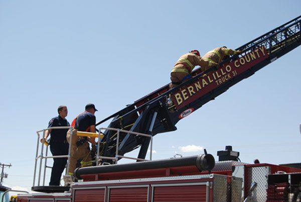 A picture of firefighters and a fire truck