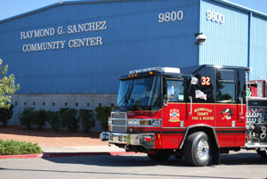 A picture of a fire truck in front of a community center