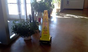 Yellow cone sitting on a floor