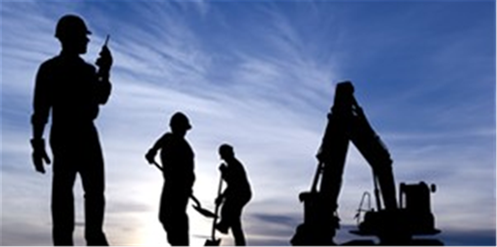Silhouettes of construction workers and backhoe